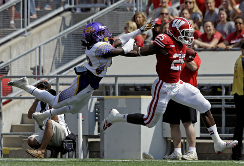 Wisconsin's Melvin Gordon (25) breaks away from Tennessee Tech's Matt Hamby for a 37-yard touchdown run during the first half of an NCAA college football game Saturday, Sept. 7, 2013, in Madison, Wis. (AP Photo/Morry Gash)