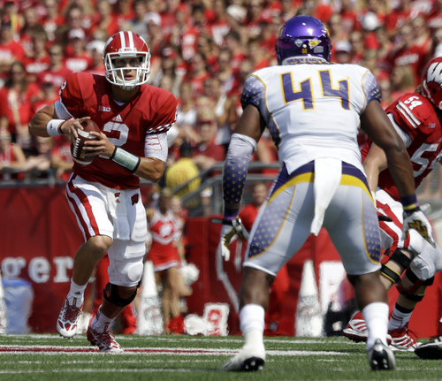 Wisconsin quarterback Joel Stave scrambles with Tennessee Tech's Blake Adams (44) defending during the first half of an NCAA college football game Saturday, Sept. 7, 2013, in Madison, Wis. (AP Photo/Morry Gash)