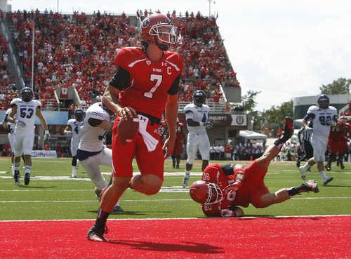 Scott Sommerdorf   |  The Salt Lake Tribune Utah Utes quarterback Travis Wilson (7) finishes off a 51 yard TD run to make the score 35-0. Utah cruised to a 49-0 halftime lead over Weber State, Saturday, September 7, 2013.