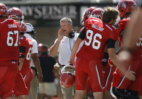 Scott Sommerdorf   |  The Salt Lake Tribune Utah Utes head coach Kyle Whittingham yells at his players during first half play. Utah cruised to a 49-0 halftime lead over Weber State, Saturday, September 7, 2013.