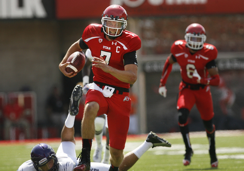 Scott Sommerdorf   |  The Salt Lake Tribune Utah Utes quarterback Travis Wilson (7) grits out a 51 yard TD run to make the score 35-0 Utah. Utah cruised to a 49-0 halftime lead over Weber State, Saturday, September 7, 2013.