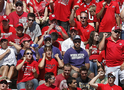 Scott Sommerdorf   |  The Salt Lake Tribune Quiet and disappointed Weber State fans watch as the score mounts inside a sea of red Ute fans. Utah cruised to a 49-0 halftime lead over Weber State, Saturday, September 7, 2013.