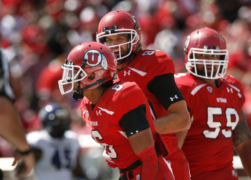 Scott Sommerdorf   |  The Salt Lake Tribune Utah Utes wide receiver Sean Fitzgerald (83), center, celebrates with Utah Utes wide receiver Dres Anderson (6) after Anderson's 57 yard TD catch and run to make the score 28-0. Utah cruised to a 49-0 halftime lead over Weber State, Saturday, September 7, 2013.