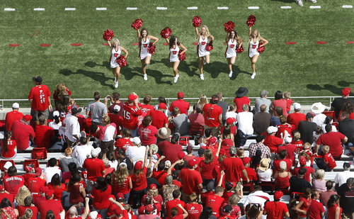 Scott Sommerdorf   |  The Salt Lake Tribune Utah cheerleaders keep the crowd entertained long after the game was no longer in doubt, during second half play. Utah crushed Weber State 70-7, Saturday, September 7, 2013.