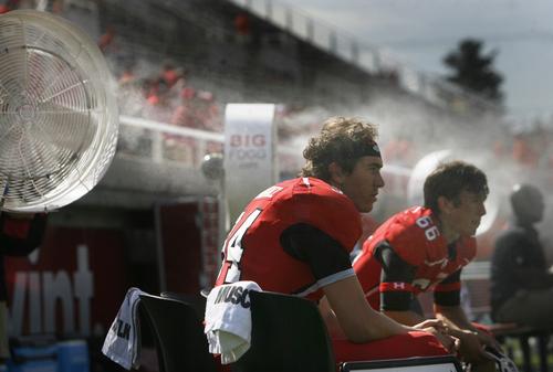 Scott Sommerdorf   |  The Salt Lake Tribune Utah players sit in a fog of mist during pre-game activities, Saturday, September 7, 2013.
