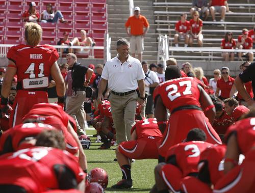 Scott Sommerdorf   |  The Salt Lake Tribune Utah Utes head coach Kyle Whittingham looks over his team during pre-game activities, Saturday, September 7, 2013.