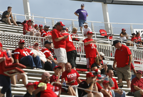 Scott Sommerdorf   |  The Salt Lake Tribune Dave Wright, a lone Weber State fan surveys his vantage point from inside a growing sea of red during pre-game activities, Saturday, September 7, 2013.