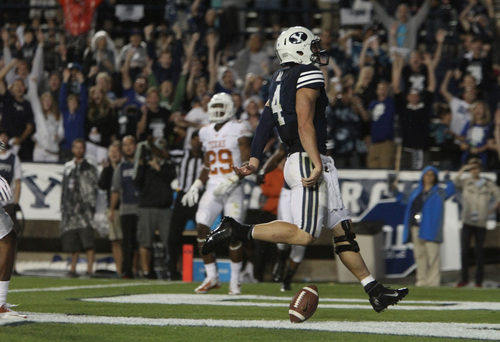 Rick Egan  | The Salt Lake Tribune    Brigham Young Cougars quarterback Taysom Hill (4) scores his second touchdown of the night as BYU played the University of Texas, Lavell Edwards stadium, Saturday, September 7, 2013.