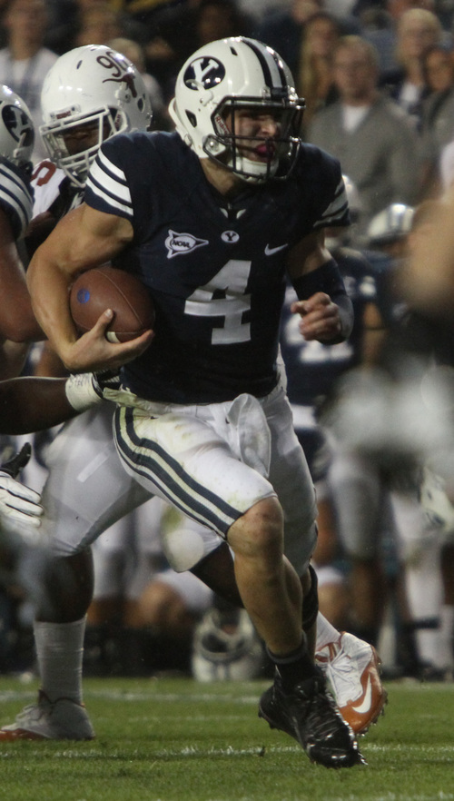 Rick Egan  | The Salt Lake Tribune    Brigham Young Cougars quarterback Taysom Hill (4)runs for his second touchdown of the night as BYU played the University of Texas, Lavell Edwards stadium, Saturday, September 7, 2013.