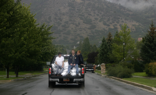 Scott Sommerdorf   |  The Salt Lake Tribune Volunteers head up into the flood area with sandbags after mudslides in Alpine, Sunday, September 8, 2013.