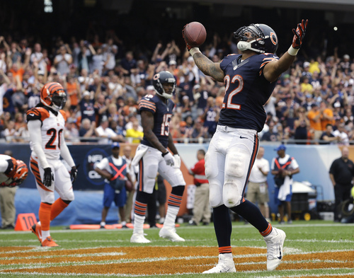 Chicago Bears running back Matt Forte (22) celebrates after rushing for a touchdown against the Cincinnati Bengals during the second half of an NFL football game, Sunday, Sept. 8, 2013, in Chicago. (AP Photo/Nam Y. Huh)