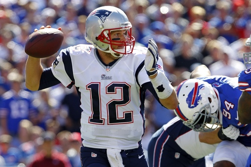 New England Patriots quarterback Tom Brady (12) throws a pass during the second half of an NFL football game against the Buffalo Bills, Sunday, Sept. 8, 2013, in Orchard Park. (AP Photo/Bill Wippert)