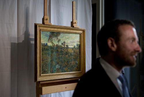 "Van Gogh Museum director Axel Ruger, right, is interviewed as he stands next to newly discovered ""Sunset at Montmajour"" painting by Dutch painter Vincent van Gogh during a press conference at the Van Gogh museum in Amsterdam, Netherlands, Monday Sept. 9, 2013. The Van Gogh Museum says it has identified a long-lost Vincent Van Gogh painting that spent years in a Norwegian attic, the first full-size canvas by the Dutch master discovered since 1928. The museum said the painting belongs to an unidentified private collector and will be on display at the museum from Sept. 24.  (AP Photo/Peter Dejong)"