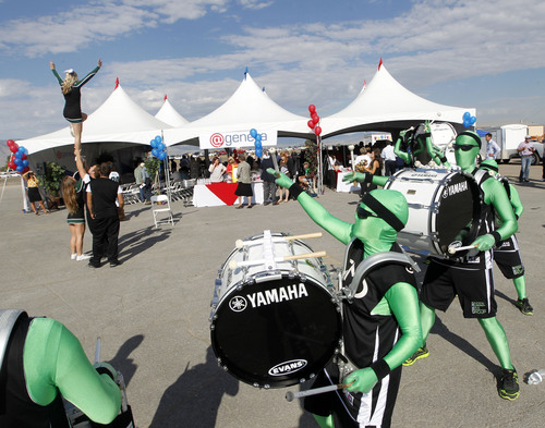 Al Hartmann  |  The Salt Lake Tribune The Green Men drum group and cheerleaders from Utah Valley University greet visitors for the announcment of @Geneva, a large master-planned community on the site of the old Geneva steel mill in Utah Countyon  Friday Sept. 6. Matthew Holland, president of UVU, didn't deny rumors that the fast-growing university might build a football stadium. (He didn't confirm them either.)