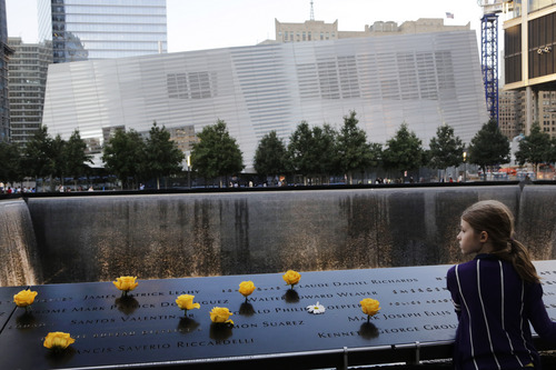 Charlotte Newman, 8, visits the National September 11 Memorial and Museum, Sunday, Sept. 8, 2013 in New York. Twelve years after terrorists destroyed the old World Trade Center, the new World Trade Center is becoming a reality, with a museum commemorating the attacks and two office towers where thousands of people will work set to open within the next year. (AP Photo/Mark Lennihan)