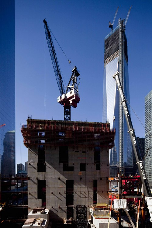 FILE - In this Oct. 12, 2012, file photo, a crane, center, works on the seventh floor of 3 World Trade Center. The skyscraper is planned to reach 80 stories at 1,150 feet (378 meters) when it's expected to be completed in 2016. On the right is 1 World Trade Center and 4 World Trade Center is on the left. Twelve years after terrorists destroyed the old World Trade Center, the new World Trade Center is becoming a reality, with a museum commemorating the attacks and two office towers where thousands of people will work set to open within the next year. (AP Photo/Mark Lennihan, File)