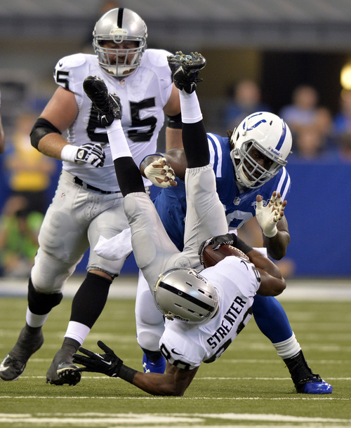 Oakland Raiders wide receiver Rod Streater, bottom, is upended as he's hit by Indianapolis Colts nose tackle Ricky Jean Francois during the first half of an NFL football game in Indianapolis, Sunday, Sept. 8, 2013. (AP Photo/Doug McSchooler)