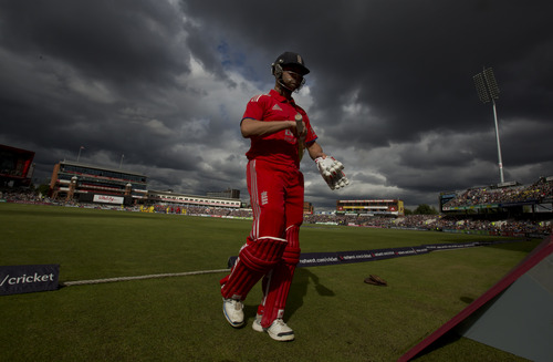 England's Jonathan Trott walks from the pitch after losing his wicket for  0 off the bowling of Australia's Mitchell Johnson during their One Day International cricket match at Old Trafford cricket ground, Manchester, England, Sunday, Sept. 8, 2013. (AP Photo/Jon Super)