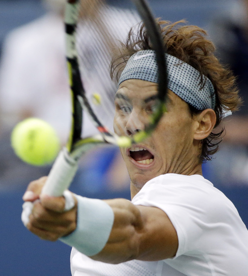 Rafael Nadal, of Spain, returns a shot to Richard Gasquet, of France, during the semifinals of the 2013 U.S. Open tennis tournament, Saturday, Sept. 7, 2013, in New York. (AP Photo/David Goldman)