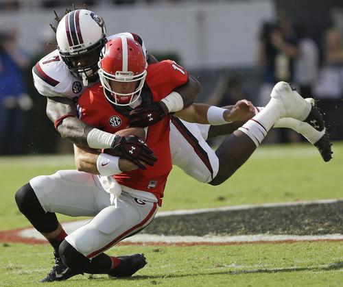 South Carolina defensive end Jadeveon Clowney (7) tackles Georgia quarterback Aaron Murray (11) during the first half of an NCAA football game, Saturday, Sept. 7, 2013, in Athens, Ga. (AP Photo/John Bazemore)