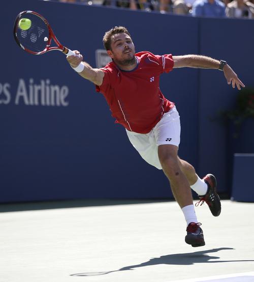 Stanislas Wawrinka, of Switzerland, returns a shot to Novak Djokovic, of Serbia, during the semifinals of the 2013 U.S. Open tennis tournament, Saturday, Sept. 7, 2013, in New York. (AP Photo/Darron Cummings)