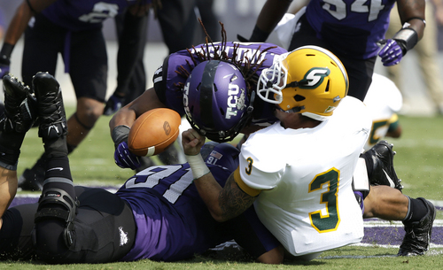 TCU linebacker Jonathan Anderson (41) and defensive end Matt Anderson (91)  sacksand force a fumble by Southeastern Louisiana quarterback Bryan Bennett (3) during the first half of an NCAA college football game Saturday, Sept. 7, 2013, in Fort Worth, Texas. (AP Photo/LM Otero)