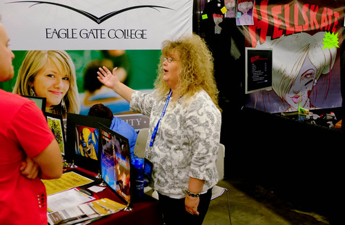Trent Nelson  |  The Salt Lake Tribune The booth for Eagle Gate College, next door to the both for Hellskate at Salt Lake Comic Con in Salt Lake City Saturday, September 7, 2013.