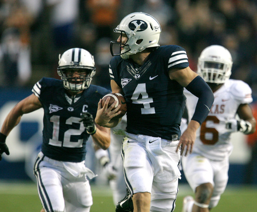 Rick Egan  | The Salt Lake Tribune    Brigham Young Cougars quarterback Taysom Hill (4) looks over his shoulder as he runs for a 68 yard touchdown as BYU played the University of Texas, Lavell Edwards stadium, Saturday, September 7, 2013.