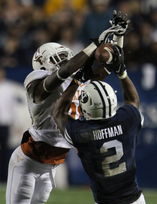 Rick Egan  | The Salt Lake Tribune   Brigham Young Cougars wide receiver Cody Hoffman (2) catches a pass as Texas Longhorns Duke Thomas (21) defends,  as BYU played the University of Texas, Lavell Edwards stadium, Saturday, September 7, 2013.