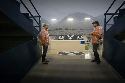 Rick Egan  | The Salt Lake Tribune   BYU ushers stand guard in the west stands, as fans were told to seek cover from the rain and lightening, as a huge rainstorm hit Lavell Edwrds stadium, an hour before game time, as BYU prepared to face the University of Texas, Saturday, September 7, 2013. The game was delayed due to lightening.