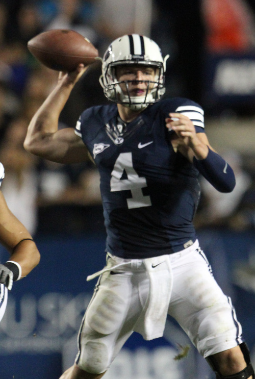 Rick Egan  | The Salt Lake Tribune   Brigham Young Cougars quarterback Taysom Hill (4) throws for the cougars, in their 40-21 win over the University of Texas at Lavell Edwards stadium, Saturday, September 7, 2013.