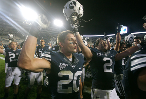Rick Egan  | The Salt Lake Tribune   Brigham Young Cougars defensive back Craig Bills (20) and Brigham Young Cougars linebacker Spencer Hadley celebrate their 40-21 win over the University of Texas at Lavell Edwards stadium, Saturday, September 7, 2013.