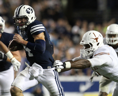Rick Egan  | The Salt Lake Tribune    Brigham Young Cougars quarterback Taysom Hill (4) runs for his third touchdown of the game, as BYU played the University of Texas, Lavell Edwards stadium, Saturday, September 7, 2013.