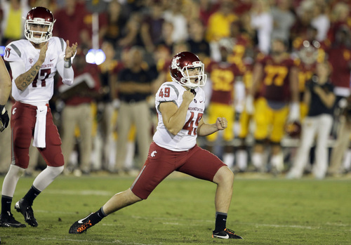 Washington State kicker Andrew Furney celebrates after kicking the winning field goal during the second half of an NCAA college football game against Southern California in Los Angeles, Saturday, Sept. 7, 2013. Washington State defeated Southern California 10-7 for its first victory at the Coliseum in 13 years. (AP Photo/Chris Carlson)