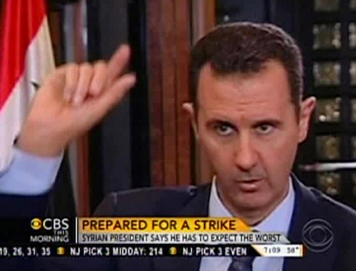 "In this frame grab from video taken Sunday, Sept. 8, 2013, and provided by ""CBS This Morning,"" Syrian President Bashar Assad responds to a question from journalist Charlie Rose during an interview in Damascus, Syria. In the interview broadcast Monday on CBS, Assad threatened to retaliate for any military strike launched in response to the alleged chemical weapons attack. ""You should expect everything,"" Assad said. (AP Photo/CBS This Morning)"