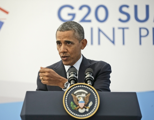 US President Barack Obama gestures during his news conference at the G-20 Summit in St. Petersburg, Russia, Friday, Sept. 6, 2013. (AP Photo/Pablo Martinez Monsivais)