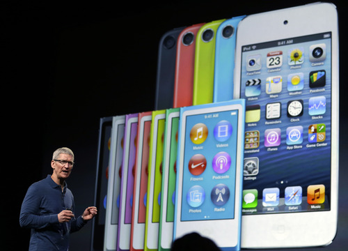 "Apple CEO Tim Cook speaks during an event to announce new products in San Jose, Calif., Tuesday, Oct.  23, 2012. Apple is unveiling the latest version of its iPhone, possibly named the ""iPhone 5S,"" on Sept. 10, 2013. It's rumored that it will come in a new gold or ""champagne"" color as well as have a faster processor, better camera and possibly a fingerprint sensor for security. Apple also is poised to introduce a new low-cost version of the iPhone, possibly called the ""iPhone 5C,"" that will be similar in specifications to this year's iPhone 5 but with a cheaper plastic backing that also will come in other colors. But what about other Apple products? It's more than likely that the Cupertino, Calif., company will introduce more from its stable of products than just the next iPhone and a new low-cost phone. (AP Photo/Marcio Jose Sanchez)"