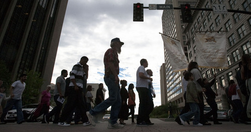 Steve Griffin  |  The Salt Lake Tribune Citizens join a prayer walk pilgrimmage Sunday in Salt Lake City to highlight the plight of immigrants and the poor Sunday. The walk started at the St. Vincent de Paul Soup Kitchen, passed by the Federal Courthouse, the Federal Building and ended at the Cathedral of the Madeleine for an evening Mass in Salt Lake City, Utah Sunday Sept. 4, 2013.