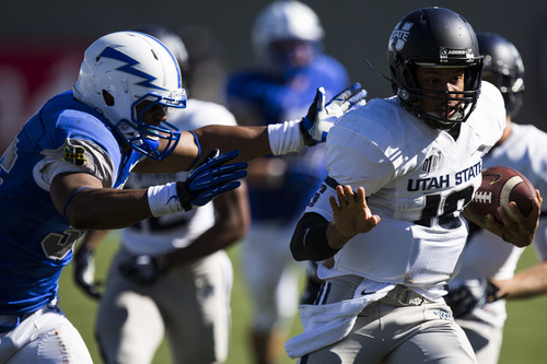 Utah State quarterback Chuckie Keeton, right, carries the ball against Air Force during an NCAA college football game on Saturday, Sept. 7, 2013, in Air Force Academy, Colo. Utah State won 52-20. (AP Photo/The Gazette, Kent Nishimura)  MAGAZINES OUT