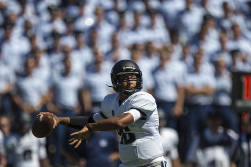 Utah State's Chuckie Keeton looks to pass during an NCAA college football game against Air Force, Saturday, Sept. 7, 2013, in Air Force Academy, Colo. Utah State won 52-20. (AP Photo/The Gazette, Kent Nishimura)  MAGAZINES OUT
