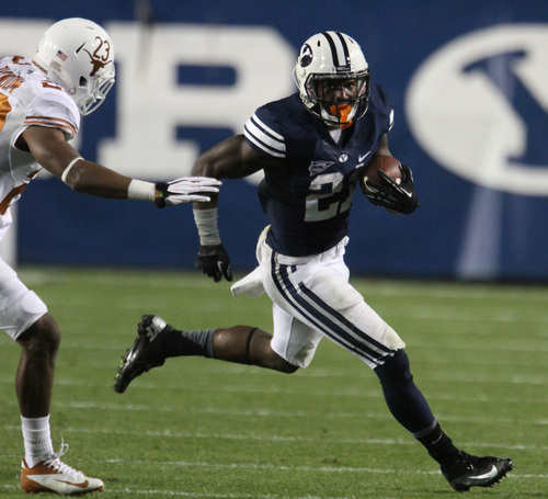 Rick Egan  |  The Salt Lake Tribune BYU running back Jamaal Williams rushes the ball against Texas, Saturday, Sept. 7, 2013. The Cougars broke all-time rushing offense records.