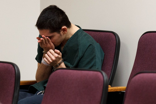 Trent Nelson  |  The Salt Lake Tribune Joshua Petersen wipes a tear from his face while sitting alone in the jury box before pleading guilty to shooting his baby to Judge Darold McDade Tuesday, September 10, 2013 in 4th District Court in Provo.