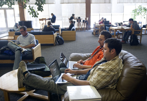 Kim Raff  |  The Salt Lake Tribune (back middle) Tristan Prescott, a freshman from Grace, ID, and (front) Rob Castleton, a junior from Alberta, Canada, study in a lounge at the Taggart Student Center on Utah State University campus in Logan on February 25, 2013. Utah State University is included in new rankings released Tuesday by U.S. News and World Report.
