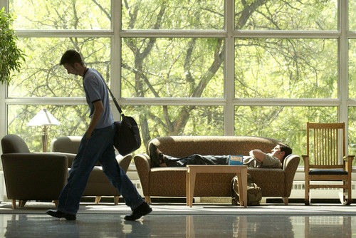 File photo | A student catches some sleep in the University of Utah's Student Union Building. The U. is ranked at No. 121 among national schools by U.S. News and World Report.