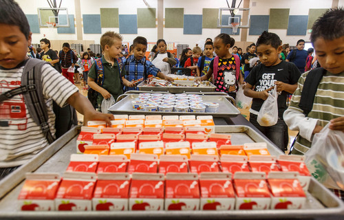 Trent Nelson  |  The Salt Lake Tribune Students pick up their breakfast at Odyssey Elementary School in Ogden Tuesday, September 3, 2013 in Ogden. At three Ogden schools, students have a new breakfast option: milk, juice, fruit and whole-grain items, and a designated breakfast period to start the day.