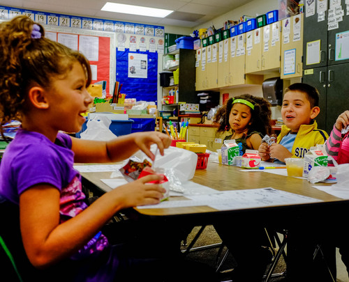 Trent Nelson  |  The Salt Lake Tribune Students eat breakfast at their desks at Odyssey Elementary School in Ogden Tuesday, September 3, 2013 in Ogden. At three Ogden schools, students have a new breakfast option: milk, juice, fruit and whole-grain items, and a designated breakfast period to start the day.