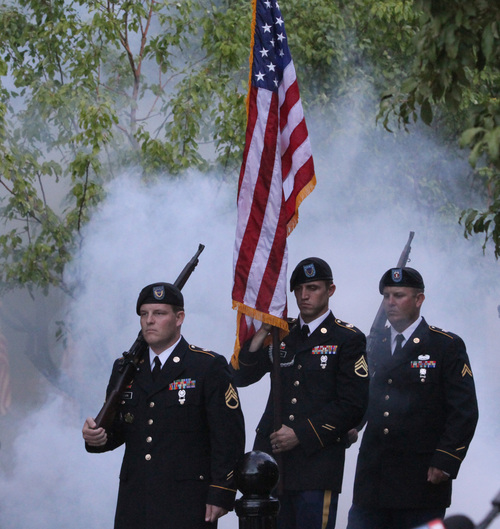 Rick Egan  | The Salt Lake Tribune   Soldiers pay tribute to Derek Johnson, and others in uniform that last their lives during the 911ceremony in front of the Sandy City Hall, Wednesday, September 11, 2013.