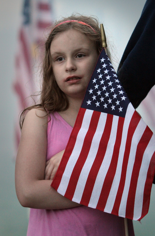 Rick Egan  | The Salt Lake Tribune   Ireland Savage, 8, Murray, stands at attention during the 911ceremony in front of the Sandy City Hall, Wednesday, September 11, 2013.