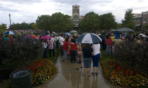 Rick Egan  | The Salt Lake Tribune   A crowd gathers in the rain for the 911ceremony in front of the Sandy City Hall, Wednesday, September 11, 2013.