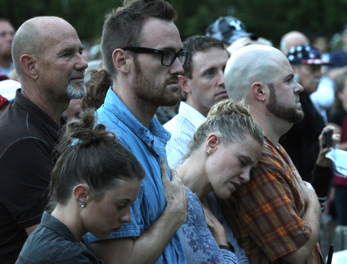 Rick Egan  |  The Salt Lake Tribune Members of Derek Johnson's family stand at attention during the National Anthem, during the 9/11 ceremony in front of the Sandy City Hall on Wednesday.